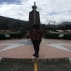 Quito, Ecuador - Walking a fine line at Mitad del Mundo (Traveltinerary)