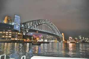 bridge under grey cloudy sky during nighttime